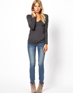 grey tshirt, skinnies, and ankle boots