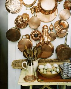"""Can't afford the real deal?  Thrift stores & garage sales always have these metal pans in """"silver""""... why not spray paint some """"copper"""" on them for a fraction of the cost!"""