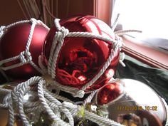 Close up of my version of Glass Ball Float as a Christmas decoration for Ventnor Happy Ours Cottage porch garland.