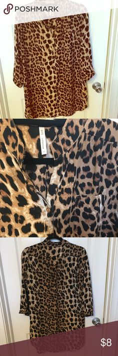 Leopard print tunic!! Cute longer leopard print top! In excellent condition. No stains, holes, tears etc. Button closure at end of sleeve or can be rolled up and buttoned to upper arm. This would be cute with a belt or layered with a vest and boots! It is a medium. Runs pretty true to size in my opinion. Not stretchy. kate collection Tops Tunics