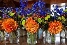 blueorange bridesmaid bouquets | blue, orange, and yellow flowers | Bouquets & Boutonnieres