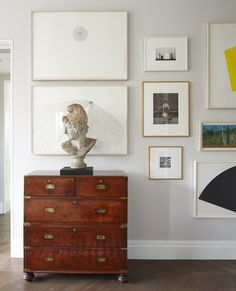 Timothy Whealon Inc.  Gramercy Park Penthouse; Living Room Design Details: Gallery Wall to display collection of quiet photographs, works on paper, & more colorful, graphic prints by Ellsworth Kelly; juxtaposition between contemporary and antique elements.