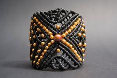 Wide black bracelet.