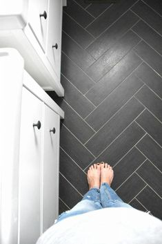 Classic gray, white, and black bathroom with herringbone tile floors Home Decor on a budget Copy this bathroom design - click through for sources! Black Tile Bathrooms, Upstairs Bathrooms, Gray Bathroom Floor Tile, Modern Bathroom, Flooring For Bathrooms, Master Bathroom, Bathrooms Online, Brown Bathroom, Minimalist Bathroom