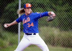 """""""The young pitcher Noah Syndergaard has become the photogenic face of a team on a mission to finish the job they started in 2015."""" (The New Yorker)"""