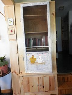 This is a cabinet my hubby built & we used an old camp screen for the door. I painted the door.
