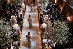 Bridesmaids wearing exquisite bridal dresses. The Great Hall dressed with hundreds of candles for the wedding ceremony