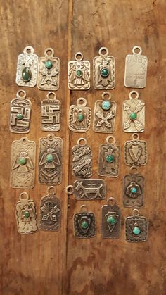 Fred Harvey era tags. Thunderbird, whirling log and arrows.