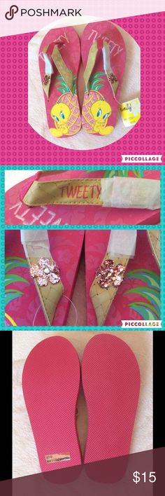 "Tweety Bird flip flops ❗️Final❗️ Brand-new never worn, never tried on. Tweety Bird flip-flops Size medium 7/8 ""Tweety"" written on the soles and on straps Pink glitter flower embellishment on each shoe. I moved the original tissue just a photograph but have placed back over the flowers to protect. Tweety bird with pineapple. Bamboo looking straps. Very light weight. Warner Brothers TM Bundle & get discount AND pay only 1 shipping. My closet has 100's of cool items & many $5 items :) Warner…"