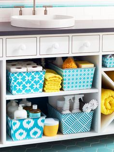 "Cleaning Supply Storage on Display  ""When a linen closet isn't an option, a spacious open vanity is the perfect place for household extras. Decorative storage bins fill the shelves of this open vanity to create a cleaning catchall that's both stylish and functional. Separate your cleaning supplies by use and neatly arrange them in bins to prevent your bathroom from looking cluttered and messy."""