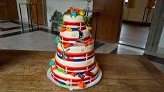 Een super leuke gestapelde bruidstaart! Een samensmelting van Denemarken en Nederland, Molens, klompen, Tulpen, Lego blokjes en de karakteristieke zeemeermin! Lego, Cake, Desserts, Food, Tulips, Tailgate Desserts, Deserts, Food Cakes, Eten