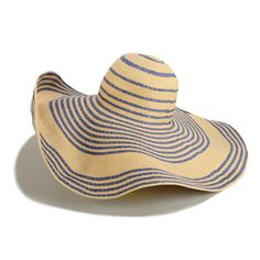 A floppy straw hat PLUS 6 more hats you'll love: http://www.womenshealthmag.com/style/straw-hats