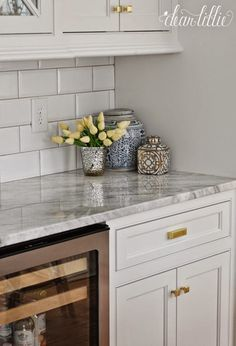 A Classic and Timeless White Kitchen  by Dear Lillie I really like these countertops. w/ some grey cabinets