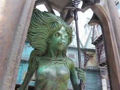 Right behind Weasleys' Wizard Wheezes is a statue of a mermaid as seen in the Hogwarts Lake from Goblet of Fire. | 17 Hidden Gems Harry Potter Fans Should Look For In Diagon Alley At Universal Orlando