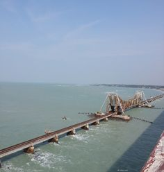 Pamban Bridge, a 2.3 km long cantilever railway bridge on the Palk Strait connecting Rameshwaram to mainland India. The snap is taken from the road bridge which runs parallel to the railway bridge.    This bridge is located at the world's second highly corrosive environment, after Miami in US, and its location is also a cyclone-prone high wind velocity zone, making its construction and maintenance a challenging task.