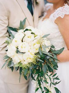 Elegant white peony bouquet: http://www.stylemepretty.com/florida-weddings/boca-raton-fl/2016/03/25/earthy-emerald-addison-wedding-in-florida/ | Photography: Rach Loves Troy - http://www.rachlovestroy.com/