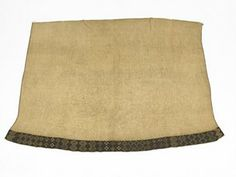 Cloak, kaitaka, made of flax fibre textile. Taniko border in traditional colours at the bottom.