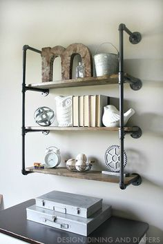today I'm sharing the Industrial Piping Shelves I built to go above his dresser. I am so in love with how they turned out. I just might be on a piping kick now.