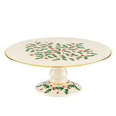 Any cake will be instantly more elegant when served on this footed plate. The top and foot bear the Holiday holly motif . Place your holiday cakes on top of this plate to create a tiered presentation.