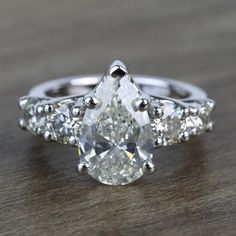Pear & Round White Five Diamond Engagement Ring in Real White Gold Radiant Cut Engagement Rings, Engagement Ring Styles, Engagement Ideas, Moissanite Diamond Rings, Pear Diamond, Fashion Rings, Trellis, Wedding Goals, Wedding Ring