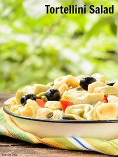 Tortellini Salad with cheese pasta, black olives, red bell peppers, artichoke hearts, and homemade dressing. Make it for your next party, BBQ, or potluck.