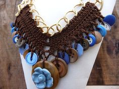 Brown Boho Necklace, Big Crochet Jewelry, Bold Vintage Buttons by GrandFernAlley, $49.50  * 24 1/2 inches long (62cm) * 22 vintage buttons * Gold-plated chain links measure 1 inch long x 3/4 inch wide (25 x 19mm) * Brown crochet thread used for central embellishment, which measures 7 1/2 inches long x 3 1/2 inches wide at center charm (191 x 89mm)