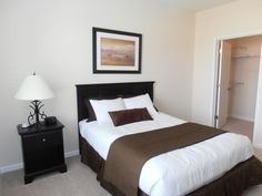 Bedroom comfortably fits a queen size bed and has a walk-in closet