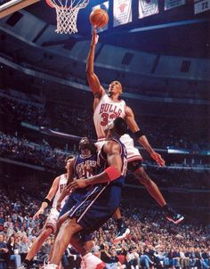 Scottie Pippen - Chicago Bulls lays the ball in against the Nets.