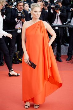 <p>Having a long career in fashion also means amassing a closet filled with amazing clothes. Kate Moss wore a vintage one-shoulder dress from Halston at a screening of <i>Loving</i>.</p><p><i>(Photo: Getty Images)</i></p>