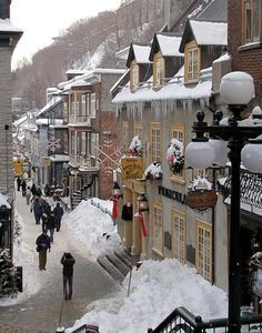 Petit Champlain, Quebec, Canada.  Photographer is standing on the old stairs, yellow pillars lead into the funicular.  (ski type lift up to the upper old city)