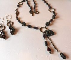 Warm, woodsy colors are blended throughout this Necklace and Earring set.