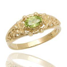 Vintage Floral Green Peridot 18k Gold Ring Peridot by netawolpe, $475.00. I love this setting.
