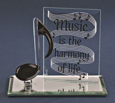 """Musical Note with message: """"Music is the harmony of life"""" with a mirror base. Item EM3 652 4"""" long Fast delivery at crystalcreations.biz"""