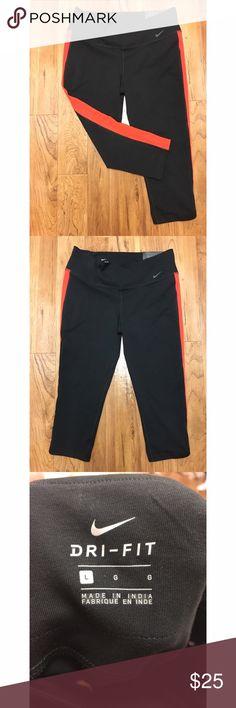 NWT Nike dri Fit leggings size L Size Large. Nike dri Fit cropped leggings. Black and orange. NWT. No flaws. Super comfortable! Hits mid calf Nike Pants Leggings