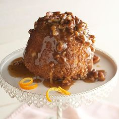 Sticky Pecan Upside-Down Baby Cakes - Brown sugar, honey, and pecans create a decadent sauce for these moist mini cakes.