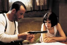 """Jean Reno  and Natalie Portman as Leon and Mathilda learning the trade.....in """"Leon:The Professional"""" (1994) Léon (original title) France"""