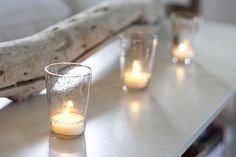 Driftwood and simple glass tea light holders - great look for the mantel!