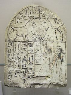 Stella of painted limestone showing an unidentified couple adoring 'The Cat of the God Re' & 'The Great Cat'. From Dier el-Medina Dyn 19 (via egyptarchive.co.uk)