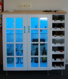 Cool bar using upper kitchen cabinets and wine storage, legs and countertop, all found at Ikea - by IKEA Hackers