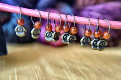 set of 9 handcrafted stitch markers - antique gold roses with orange glass bead…