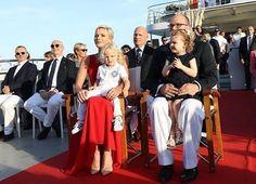 Prince Albert, Princess Charlene, Princess Gabriella and Prince Jacques. Princess Charlene wore Roland Mouret one shoulder silk dress