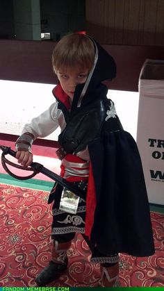 Assassin's Creed child cosplay, spotted at Youmacon 2011. DON'T steal that kid's crayons.