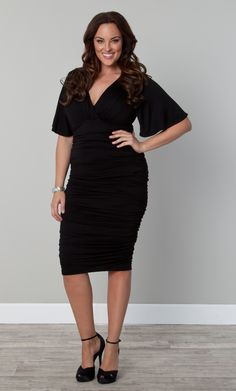 The perfect little black dress...  The Plus Size Rumor Ruched Dress by Kiyonna hugs your curves for a sexy fit.  Ruching makes it uber flattering while short flutter sleeves make it flirty. #KiyonnaPlusYou #Kiyonna #PlusSize