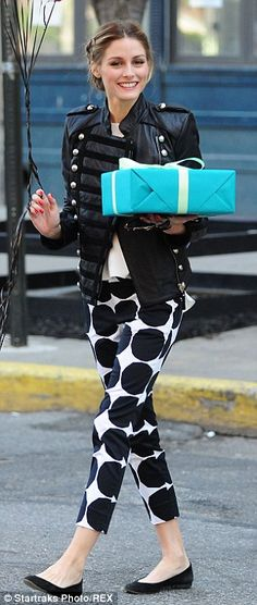 #casualwear #streetstyle   Olivia Palermo in a black & white outfit featuring a Boda military-inspired leather jacket over a white blouse and dotted Banana Republic Marimekko Collection cropped pants