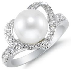 Pearl Wedding Rings that's really pretty even better if it were a diamond !