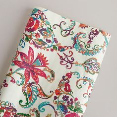 idea- paint the dresser a pale mandarin orange color and use this for the dresser fronts- Ivory Paisley Giftwrap Roll