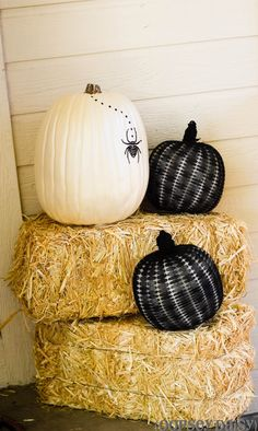 paint fake pumpkins and put a netted stocking on top for fun black and white effect!