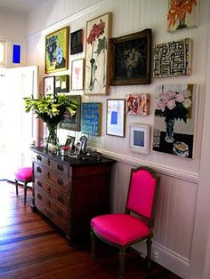 Love the variety of this wall, with splashes of different colors. Very eclectic, indie, cozy, sophisticated feel.