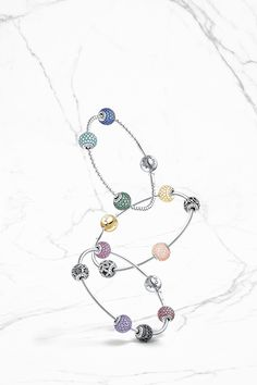 Which meaningful charms from the PANDORA ESSENCE COLLECTION capture your true essence? Click the image to take the quiz to find out.