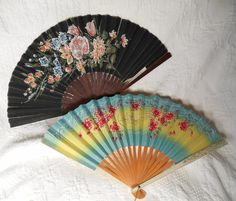Mom had several floral styled fans from Japan. She gave me some to play with as a child.  I opened/closed them so much that they got ragged so we sold them in a garage sale. I wish I had them back.